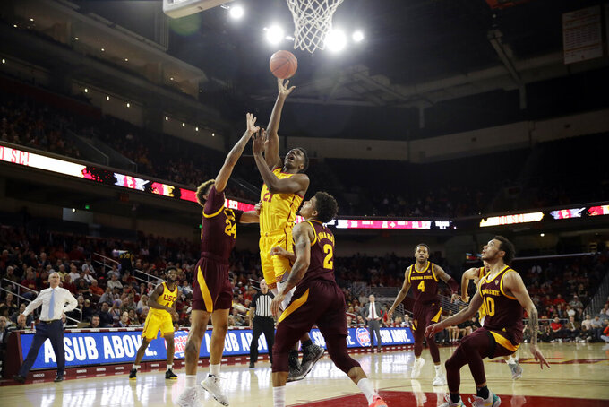 Southern California forward Onyeka Okongwu (21) shoots over Arizona State guard Rob Edwards (2) during the first half of an NCAA college basketball game Saturday, Feb. 29, 2020, in Los Angeles. (AP Photo/Marcio Jose Sanchez)
