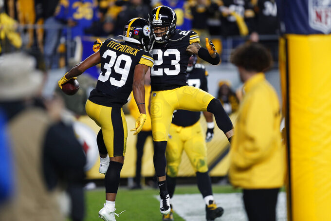 Pittsburgh Steelers free safety Minkah Fitzpatrick (39) celebrates with Joe Haden (23) after his touchdown after intercepting a pass from Los Angeles Rams quarterback Jared Goff during the first half of an NFL football game in Pittsburgh, Sunday, Nov. 10, 2019. (AP Photo/Keith Srakocic)