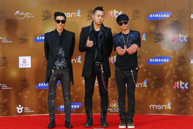 "FILE - In this Jan. 16, 2013, file photo, South Korean alternative hip-hop group Epik High poses for photographers as they arrive on the red carpet ahead of the 27th Golden Disk Awards at Sepang International Circuit in Sepang, Malaysia. Popular South Korean hip-hop trio Epik High was working on a song called ""End of the World"" before the pandemic hit in 2020. Now, the band's frontman Tablo says, ""I wish that this song is not relevant."" (AP Photo/Lai Seng Sin, File)"