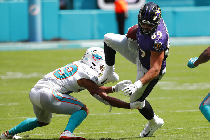 Miami Dolphins free safety Minkah Fitzpatrick (29) tackles Baltimore Ravens tight end Mark Andrews (89), during the first half at an NFL football game, Sunday, Sept. 8, 2019, in Miami Gardens, Fla. (AP Photo/Wilfredo Lee)