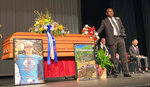 FILE - Attorney Ben Crump stands next to Hunter Brittain's casket at the Beebe High School Auditorium before his memorial service in Beebe, Ark., on Tuesday, July 6, 2021. Brittain was shot and killed by a Lonoke County Sheriff's deputy during a traffic stop June 23. (AP Photo/Andrew Demillo, File)