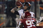 Oklahoma State quarterback Shane Illingworth (16) throws under pressure from Oklahoma defensive lineman Isaiah Thomas (95) during the first half of an NCAA college football game in Norman, Okla., Saturday, Nov. 21, 2020. (AP Photo/Sue Ogrocki)