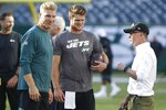 CORRECTS EAGLES QUARTERBACK TO JOSH MCCOWN, INTEAD OF CARSON WENTZ - CORRECTS PERSON AT RIGHT TO CHRISTOPHER JOHNSON, INSTEAD OF WOODY JOHNSON - Philadelphia Eagles quarterback Josh McCown, left, New York Jets quarterback Sam Darnold, center, and Jets CEO and chairman Christopher Johnson talk before a preseason NFL football game Thursday, Aug. 29, 2019, in East Rutherford, N.J. (AP Photo/Jim McIsaac)