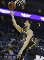 Golden State Warriors' Klay Thompson lays up a shot against the Chicago Bulls during the first half of an NBA basketball game Friday, Jan. 11, 2019, in Oakland, Calif. (AP Photo/Ben Margot)