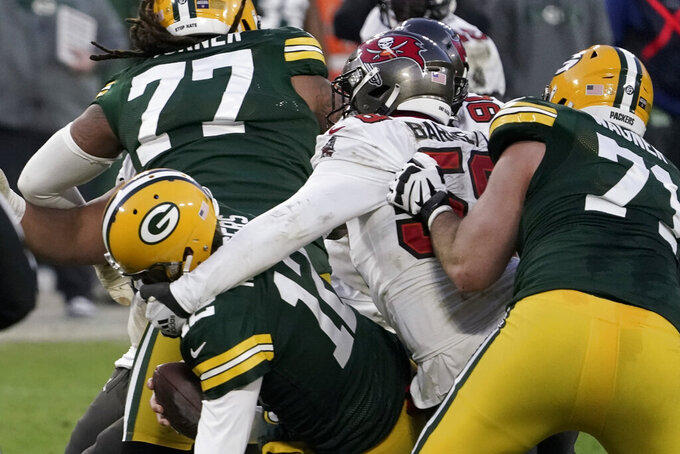 Tampa Bay Buccaneers' Shaquil Barrett (58) sacks Green Bay Packers quarterback Aaron Rodgers (12) during the second half of the NFC championship NFL football game in Green Bay, Wis., Sunday, Jan. 24, 2021. (AP Photo/Morry Gash)