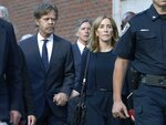 Felicity Huffman leaves federal court with her husband William H. Macy, left, and her brother Moore Huffman Jr. rear center, after she was sentenced in a nationwide college admissions bribery scandal, Friday, Sept. 13, 2019, in Boston. (AP Photo/Michael Dwyer)