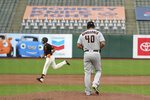 Arizona Diamondbacks starting pitcher Madison Bumgarner walks on the mound after giving up a home run to San Francisco Giants' Evan Longoria, left, during the second inning of a baseball game Saturday, Sept. 5, 2020, in San Francisco. (AP Photo/Eric Risberg)