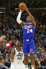 Sacramento Kings guard Buddy Hield (24) shoots as Utah Jazz guard Donovan Mitchell (45) defends during the first half during an NBA basketball game Saturday, Jan. 18, 2020, in Salt Lake City. (AP Photo/Rick Bowmer)