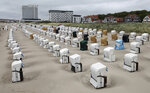 Beach chairs placed in lines at the Baltic Sea beach in Warnemuende, Germany, May 25, 2020. Germany's northern states are starting to reopen the touristic hotspots after the lockdown because of the coronavirus crisis and hope that German tourists will come. (Bernd Wuestneck/dpa via AP)