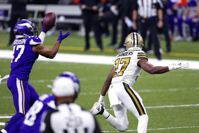 Minnesota Vikings middle linebacker Hardy Nickerson (47) intercepts a pass intended for New Orleans Saints wide receiver Emmanuel Sanders (17) in the second half of an NFL football game in New Orleans, Friday, Dec. 25, 2020. (AP Photo/Butch Dill)