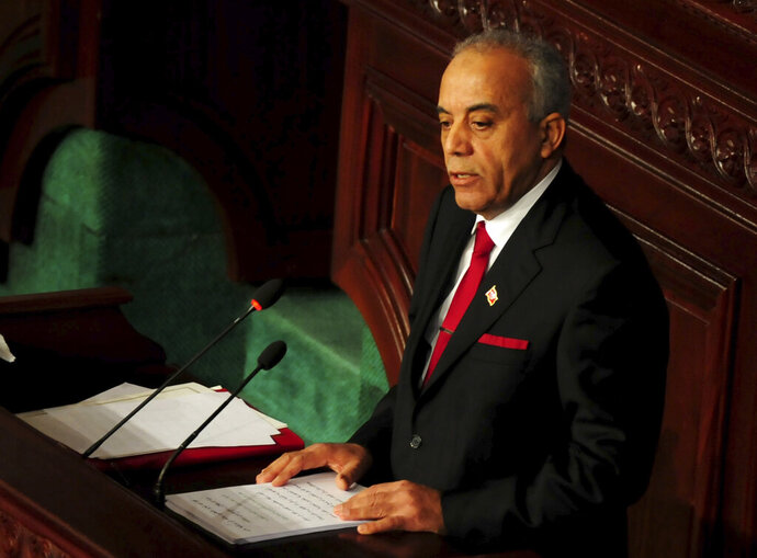 Tunisian designated Prime Minister Habib Jemli, delivers his speech at the parliament, Friday Jan. 10, 2020. Tunisia's parliament is expected to hold a confidence vote Friday on designated prime minister Habib Jemli's government. (AP Photo/Hassene Dridi)