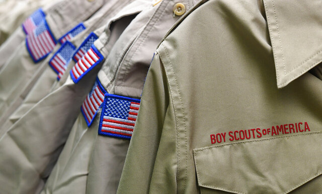 FILE - In this Feb. 18, 2020, file photo, Boy Scouts of America uniforms are displayed in the retail store at the headquarters for the French Creek Council of the Boy Scouts of America in Summit Township, Pa.  Under the oversight of a bankruptcy judge, the Boy Scouts of America has launched a nationwide advertising campaign notifying victims of decades-ago sex abuse by scout leaders that they have until Nov. 16, 2020, to file claims seeking a share of a proposed compensation fund.  (Christopher Millette/Erie Times-News via AP, File)