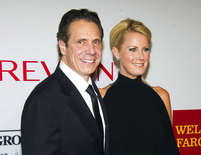 FILE - In this Oct. 28, 2014 file photo, New York Gov. Andrew Cuomo, left, and Sandra Lee attend the Elton John AIDS Foundation's 13th Annual