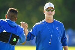 Indianapolis Colts head coach Frank Reich greets players before the start of practice at the NFL team's football training camp in Westfield, Ind., Monday, Aug. 2, 2021. Reich returned to practice following his quarantine period and two negative tests after a positive test for COVID-19. (AP Photo/Michael Conroy)