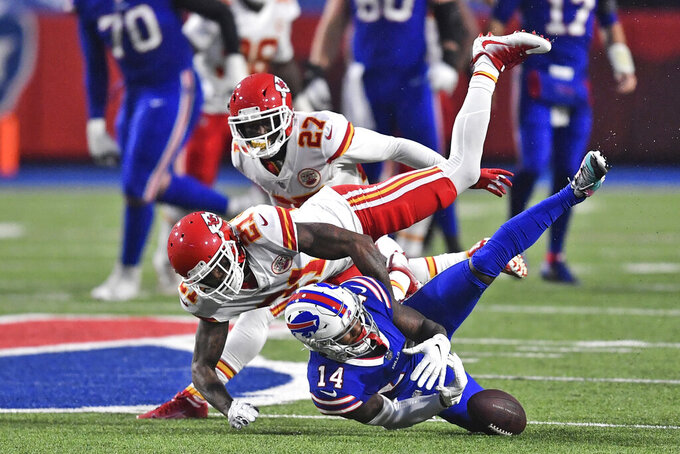 Buffalo Bills' Stefon Diggs, bottom, loses the ball as he is tackled by the Kansas City Chiefs defense during the first half of an NFL football game, Monday, Oct. 19, 2020, in Orchard Park, N.Y. (AP Photo/Adrian Kraus)