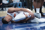 New York Knicks forward Kevin Knox reacts after injuring himself during the first half of an NBA basketball game against the Boston Celtics, Saturday, Oct. 20, 2018, at Madison Square Garden in New York. (AP Photo/Mary Altaffer)