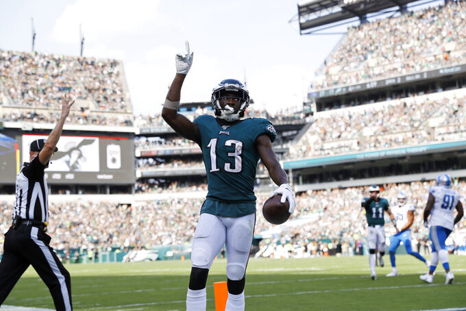 Philadelphia Eagles' Nelson Agholor (13) celebrates after scoring a touchdown during the second half of an NFL football game against the Detroit Lions, Sunday, Sept. 22, 2019, in Philadelphia. (AP Photo/Michael Perez)