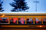 FILE - In this Dec. 16, 2012 file photo, people arrive on a school bus at Newtown High School for a memorial vigil attended by President Barack Obama for the victims of the Sandy Hook Elementary School shooting, in Newtown, Conn.  Most of the students who commit deadly school attacks were bullied, had a history of disciplinary trouble and their behavior concerned others, but it wasn't reported. That's according to a comprehensive study by the U.S. Secret Service's National Threat Assessment Center of 41 school attacks since the 1999 Columbine High School Shooting.  (AP Photo/David Goldman)