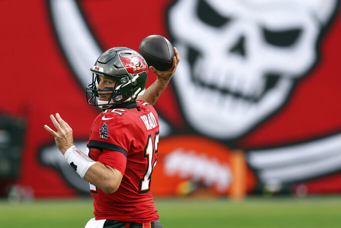 Tampa Bay Buccaneers quarterback Tom Brady (12) throws a pass against the Minnesota Vikings during the first half of an NFL football game Sunday, Dec. 13, 2020, in Tampa, Fla. (AP Photo/Mark LoMoglio)
