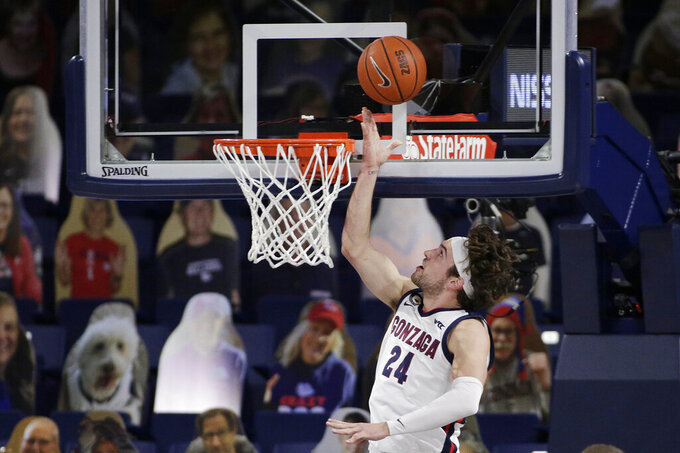 Gonzaga forward Corey Kispert shoots during the first half of an NCAA college basketball game against Santa Clara in Spokane, Wash., Thursday, Feb. 25, 2021. (AP Photo/Young Kwak)