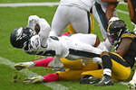 Philadelphia Eagles running back Miles Sanders (26), left, scores during the first half of an NFL football game against the Pittsburgh Steelers in Pittsburgh, Sunday, Oct. 11, 2020. (AP Photo/Don Wright)