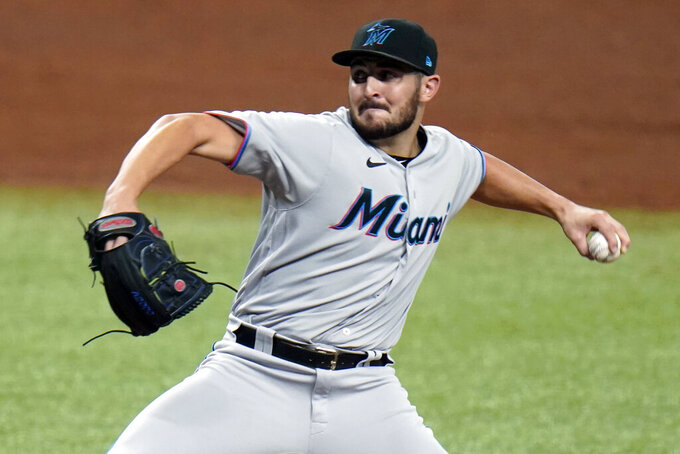 FILE - In this Sept. 4, 2020, file photo, Miami Marlins relief pitcher Alex Vesia (96) throws during the fifth inning of a baseball game in St. Petersburg, Fla. Well-traveled right-handed reliever Dylan Floro was traded Friday, Dec. 12, 2021, by the Los Angeles Dodgers to the Miami Marlins for left-handed reliever Alex Vesia and pitching prospect Kyle Hurt. (AP Photo/Chris O'Meara, File)