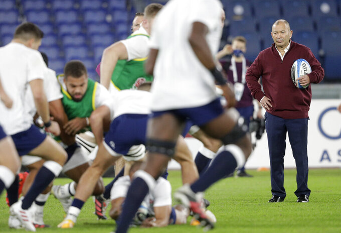 England's head coach Eddie Jones, right watches his players during the warm up ahead of the Six Nations rugby union international match between Italy and England at the Olympic Stadium in Rome, Italy, Saturday, Oct. 31, 2020. (AP Photo/Gregorio Borgia)