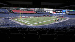 The seats in Gillette Stadium remain empty due to the coronavirus pandemic before an NFL football game between the New England Patriots and Las Vegas Raiders, Sunday, Sept. 27, 2020, in Foxborough, Mass. (AP Photo/Steven Senne)
