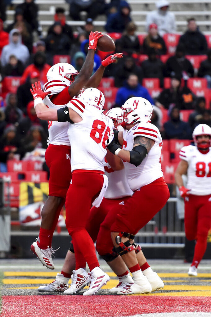 Nebraska running back Dedrick Mills (26) celebrates with teammates after scoring a touchdown during the first half of an NCAA college football game against Maryland, Saturday, Nov. 23, 2019, in College Park, Md. (AP Photo/Will Newton)