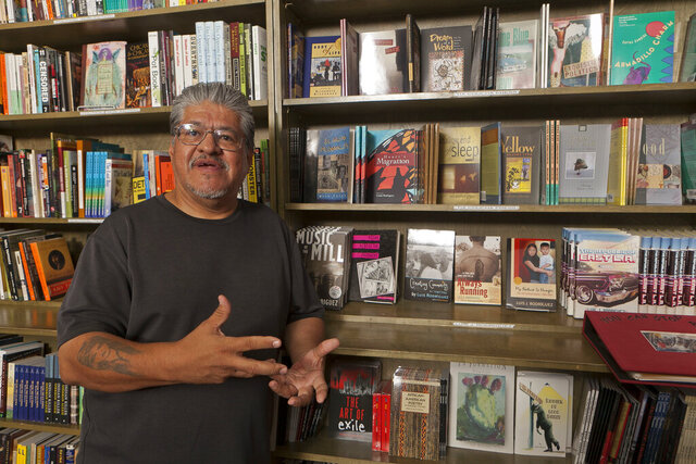 FILE - In this file photo taken Monday, Sept. 12, 2011, writer and activist Luis J. Rodriguez poses for a photo at his independent bookstore and community center