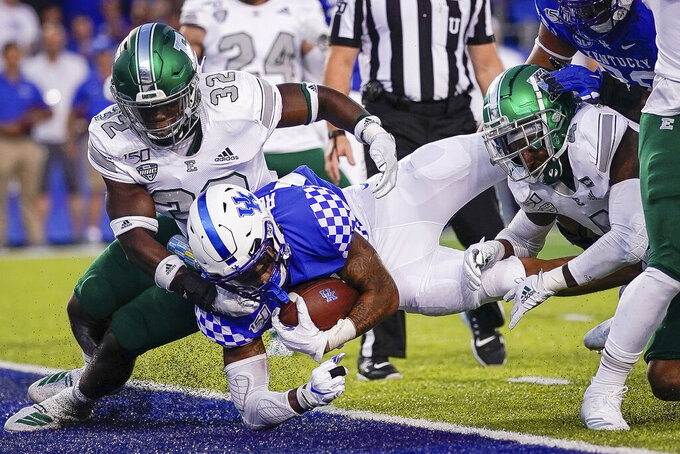 Kentucky running back Asim Rose (10) scores a touchdown during the first half of an NCAA college football game between Kentucky and Eastern Michigan, Saturday, Sept. 7, 2019, in Lexington, Ky. (AP Photo/Bryan Woolston)