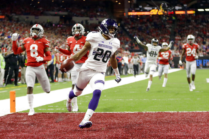 Northwestern running back John Moten IV (20) runs for a touchdown during the first half of the Big Ten championship NCAA college football game against Ohio State, Saturday, Dec. 1, 2018, in Indianapolis. (AP Photo/AJ Mast)