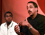 FILE- In this July 15, 1997, file photo Gregory Hines, right, briefs the members of Television Critic's Association during the CBS' part of the TCA press tour as his co-star Brandon Hammond, who will play Hines' son in the new television series