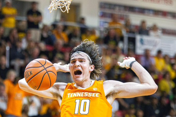 Tennessee forward John Fulkerson (10) reacts after a dunk in the first half ball game against Virginia Commonwealth at the Emerald Coast Classic in Niceville, Fla., Saturday, Nov. 30, 2019. (AP Photo/Mark Wallheiser)