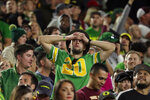 An Oregon fan reacts during the final seconds of the team's NCAA college football game against Arizona State, Saturday, Nov. 23, 2019, in Tempe, Ariz. Arizona State won 31-28. (AP Photo/Matt York)