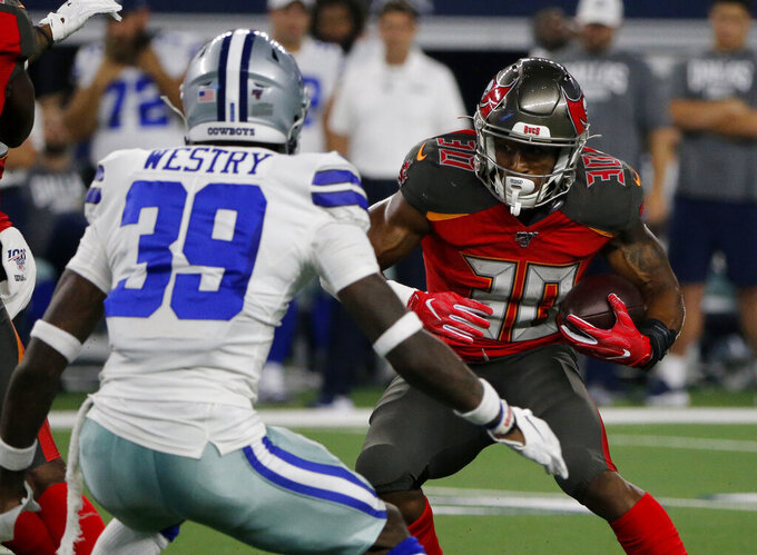 Dallas Cowboys cornerback Chris Westry (39) defends as Tampa Bay Buccaneers running back Bruce Anderson (30) runs the ball in the second half of a preseason NFL football game in Arlington, Texas, Thursday, Aug. 29, 2019. (AP Photo/Michael Ainsworth)