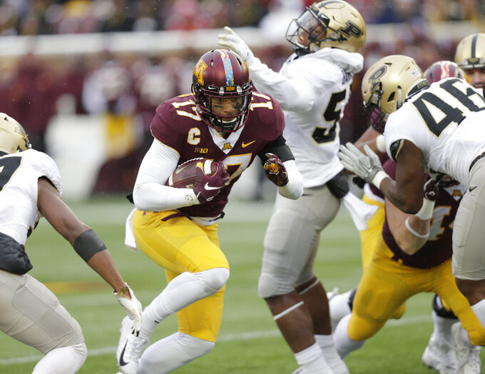 Minnesota wide receiver Seth Green (17) runs against Purdue players Derrick Barnes (55) and Comel Jones (46) in the third quarter in a NCAA college football game Saturday, Nov. 10, 2018, in Minneapolis. (AP Photo/Andy Clayton-King)
