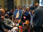 Rep. C. Denise Marcelle, D-Baton Rouge, holds a poster commemorating the legislative session, which reached its final hours on Wednesday, June 5, 2019, in Baton Rouge, La. (AP Photo/Melinda Deslatte)