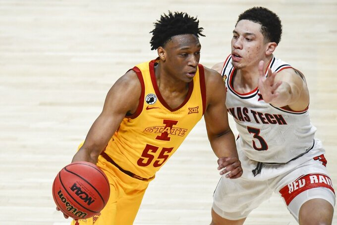Iowa State's Darlinstone Dubar (55) drives as Texas Tech's Clarence Nadolny (3) defends during the second half of an NCAA college basketball game in Lubbock, Texas, Thursday, March 4, 2021. (AP Photo/Justin Rex)