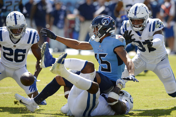 Tennessee Titans wide receiver Nick Westbrook-Ikhine (15) fumbles the ball as he is hit by Indianapolis Colts outside linebacker Darius Leonard, bottom, in the second half of an NFL football game Sunday, Sept. 26, 2021, in Nashville, Tenn. The Colts recovered the ball. (AP Photo/Mark Zaleski)
