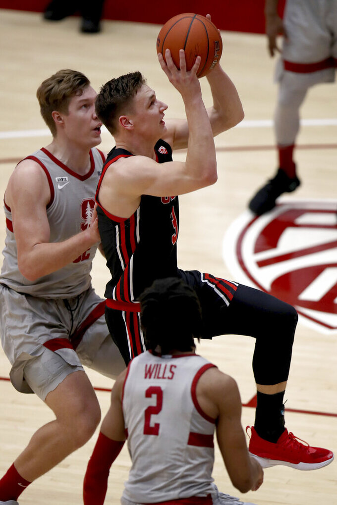 Utah guard Pelle Larsson (3) drives to the basket past Stanford forward Lukas Kisunas, left, during the first half of an NCAA college basketball game Saturday, Feb. 13, 2021, in Stanford, Calif. (AP Photo/Scot Tucker)