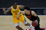Oklahoma State's Cade Cunningham (2) drives under pressure from Baylor's Mark Vital (11) during the second half of an NCAA college basketball game in the semifinals of the Big 12 tournament in Kansas City, Mo., Friday, March 12, 2021. (AP Photo/Charlie Riedel)