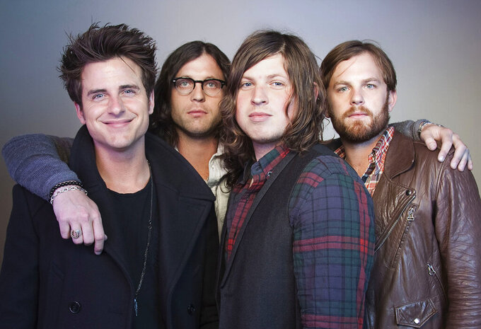 FILE - In this Oct. 21, 2010 file photo, members of the band Kings of Leon, from left, Jared Followill, Nathan Followill, Matthew Followill and Caleb Followill, pose for a portrait in New York. Rockers Kings of Leon will help kick off NFL draft activities on a stage close to the Rock & Roll Hall of Fame later this month. The Grammy Award-winning band will open the festivities on April 29, 2021 with a concert as the draft returns to a more normal state after being held virtually in 2020 due to the COVID-19 pandemic.(AP Photo/Victoria Will, File)
