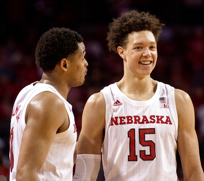 Nebraska's James Palmer Jr. (0) and Isaiah Roby talk during the team's NCAA college basketball game against Butler in the NIT on Wednesday, March 20, 2019, in Lincoln, Neb. (Francis Gardler/Lincoln Journal Star via AP)