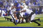 Kentucky quarterback Lynn Bowden Jr. (1) scores a touchdown during the first half of the NCAA college football game against Kentucky, Saturday, Nov. 30, 2019, in Lexington, Ky. (AP Photo/Bryan Woolston)