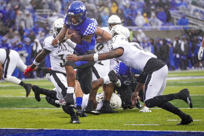 Kentucky quarterback Lynn Bowden Jr. (1) scores a touchdown during the first half of the NCAA college football game against Kentucky, Saturday, Nov. 30, 2019, in Lexington, Ky. (AP Photo/Bryan Woolston)