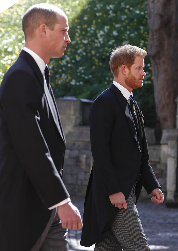 Prince William, left, and Prince Harry follow the coffin in a ceremonial procession for the funeral of Britain's Prince Philip inside Windsor Castle in Windsor, England Saturday April 17, 2021. Prince Philip died April 9 at the age of 99 after 73 years of marriage to Britain's Queen Elizabeth II. (Alastair Grant/Pool via AP)