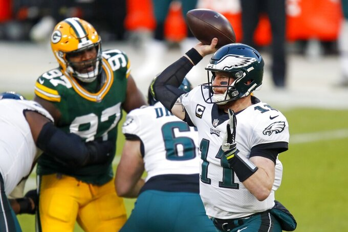 Philadelphia Eagles' Carson Wentz thorws a pass during the first half of an NFL football game against the Green Bay Packers Sunday, Dec. 6, 2020, in Green Bay, Wis. (AP Photo/Matt Ludtke)