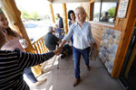 Democratic presidential candidate Sen. Kirsten Gillibrand greets local residents at a coffee shop, Saturday, May 25, 2019, in Mason City, Iowa. (AP Photo/Charlie Neibergall)