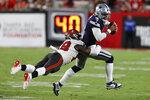 Tampa Bay Buccaneers linebacker Shaquil Barrett (58) sacks Dallas Cowboys quarterback Dak Prescott (4) during the first half of an NFL football game Thursday, Sept. 9, 2021, in Tampa, Fla. (AP Photo/Scott Audette)